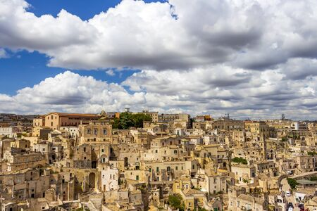 Old town elevated panoramic sunny summer view of Matera, Province of Matera, Basilicata Region, Italy 免版税图像