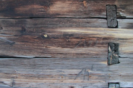Background texture. Old brown wooden wall, illuminated by the sun