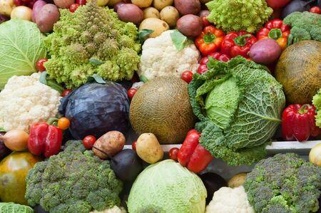 Assortment of fresh vegetables close up. Vegetables top view background. Stock fotó