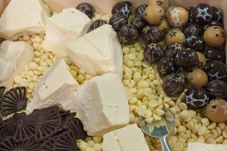 Luxury chocolate background top view. Assortment of white, dark, milk chocolate. Belgium chocolate.