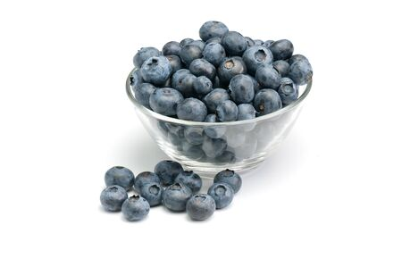 Fresh wild blueberries in glass bowl isolated on white background.