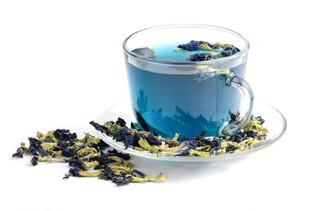 Butterfly pea flower blue tea in glass cup isolated on white background. Healthy detox herbal drink.