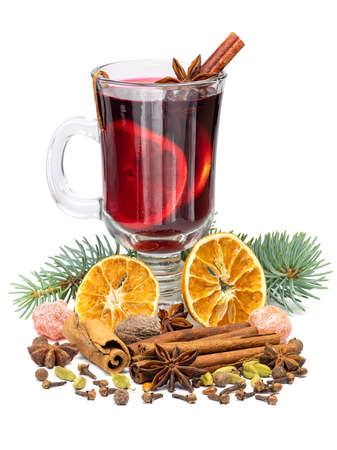 Hot red christmas mulled wine in glass with spices and fruits isolated on white background. Stock Photo