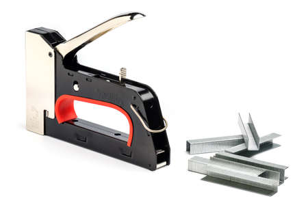 Staple Gun With Staples Isolated On White Background. Heavy-Duty Steel Staple Gun To Repairs Around Your Home.