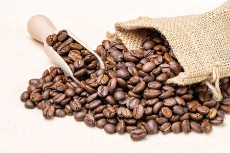 Bag with fresh roasted coffee beans isolated on white cloth.