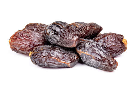 Amazing dates fruit isolated on white background. Pile of dried premium dates close-up.