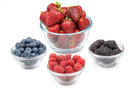 Fresh berries strawberries, raspberries, blackberries and blueberries in glass bowls isolated on white background. Berries in bowl.