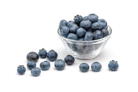 Fresh blueberries in glass bowl isolated on white background.
