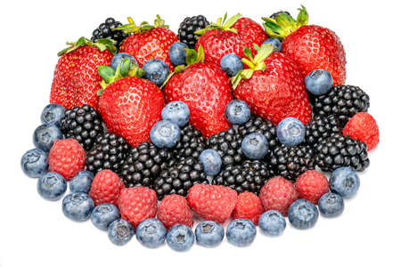 Fresh berries strawberries, raspberries, blackberries and blueberries isolated on white background. Heap of different berries top view.