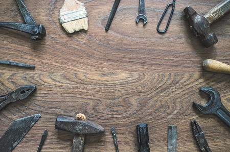 rasp: Different tools (pliers, hammer, wrench, nippers, chisel, rasp, screwdriver) on a wooden background. Fathers day card with copy space. Stock Photo