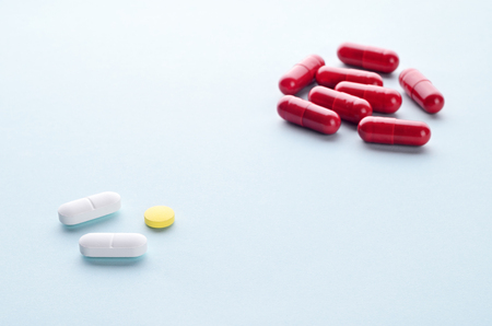 psychotropic medication: Assorted colorful pills and capsules on a light background close up, horizontal, copy space, selective focus, medical concept. Stock Photo