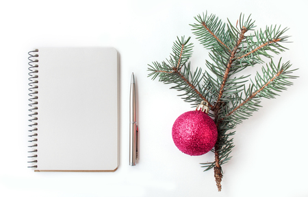 marry christmas: Notepad with fir branch, isolated on a white background. Marry Christmas and Happy New Year theme