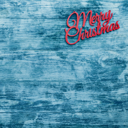 Merry Christmas square card, top view, blue wooden background. Space for Xmas congratulation text Foto de archivo
