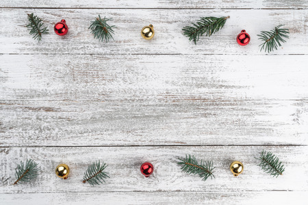 Old wooden Christmas background. Fir branches. Gold and red baubles. Christmas card. Top view. Space for your text.