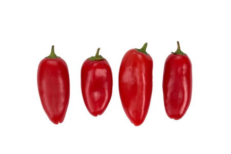 Ovely four mini red peppers on white isolate background. Fresh vegetable