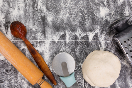 Cooking tools for pie or pizza. Food background. Food concept. Top view. Space for text Фото со стока