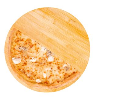 Half of pizza five cheeses on bamboo bottom, isolate, top view, space for text