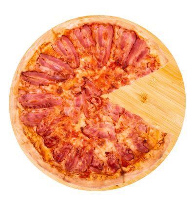 Pizza bacon, without slice, on bamboo bottom, isolate on white Stock Photo