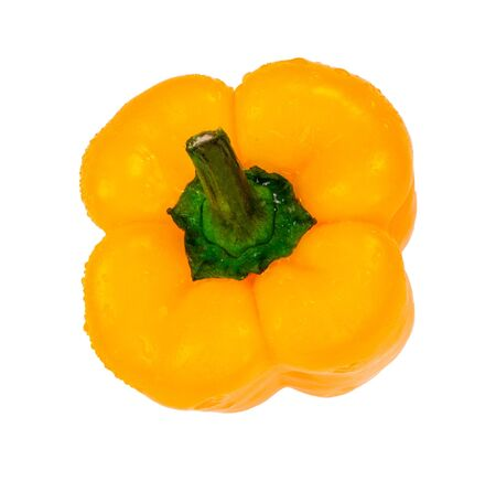 Yellow bell pepper with water drops, isolated on white background, top view. Fresh vegetable, macro photography