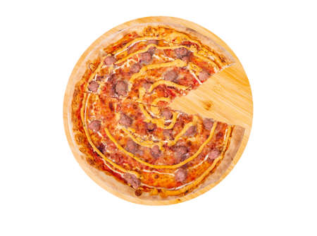 Tasty pizza with beef sausages, mozzarella, various sauces and marinated red onions, without one slice, on round wooden platter, isolated on white background, top view