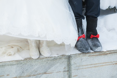 valenki: Russian felt boots on the bride and groom in winter