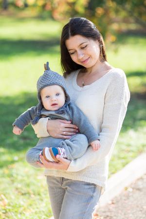 babyboy: Mother hugging her babyboy during walk in the park