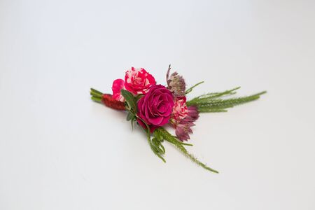 boutonniere: Beautiful wedding boutonniere of varios flowers on nice background