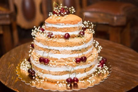 tiered: white multi level wedding cake with pink flower decorations Stock Photo