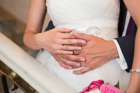 wedlock: Bride and groom holding there hands outdoors Stock Photo