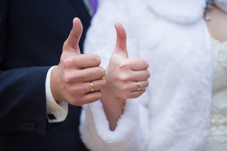 dinner jacket: Bride and groom holding there hands outdoors Stock Photo