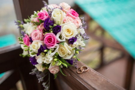 Colorful bridal beautiful bouquet of different flowers