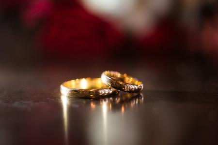 ring light: Wedding ring light illumination on the table Stock Photo