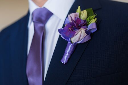 occasion: Boutonniere on hip trendy groom at wedding