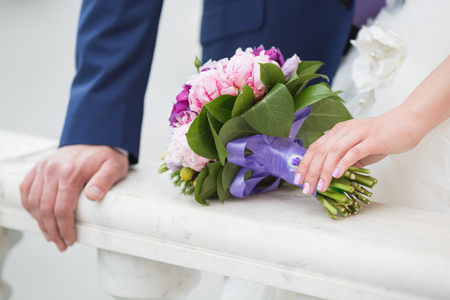 a marriage meeting: Beautiful wedding bouquet in hands of the bride