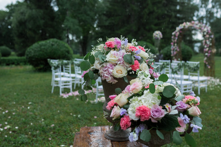 table decoration: beautiful wedding ceremony in the park in the rain Stock Photo