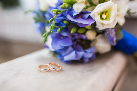 diamond rings: Two wedding rings and spring blossoms. Wedding concept.