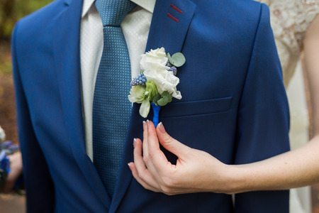 buttonhole: Boutonniere on hip trendy groom at wedding