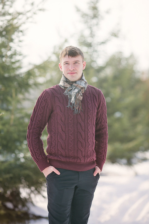 man standing alone: Outdoor portrait of trendy guy wearing scarf
