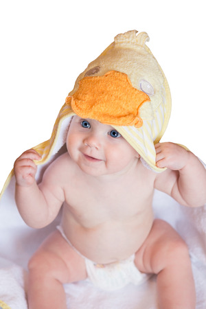 nude baby: Adorable baby, looking out under a white and yellow blanket, towel