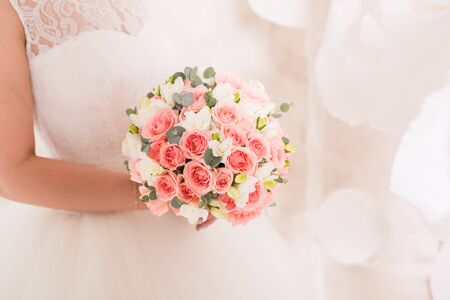 wedding bride: Beautiful wedding bouquet in hands of the bride