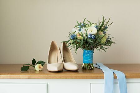 festive background: Beige Wedding shoes on the gatherings of the bride Stock Photo