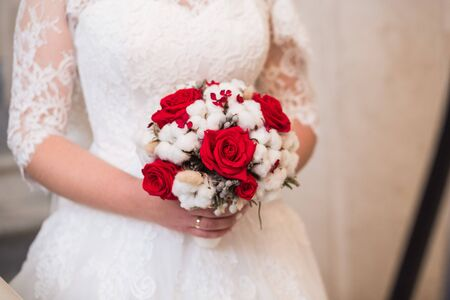 winter wedding: wedding bouquet with red roses. winter wedding bouquet.