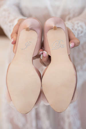 coral bell: Pink Wedding shoes with inscription I do on the gatherings of the bride
