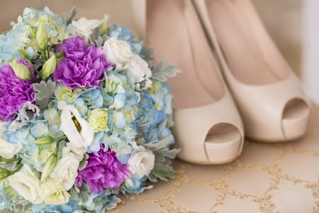coral bell: Wedding shoes with bouquet on the gatherings of the bride