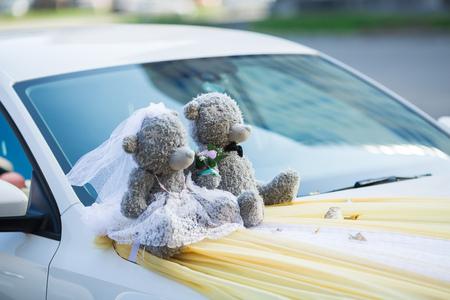 dress suit: couple toys teddy bear in dress suit decoratet wedding car Stock Photo