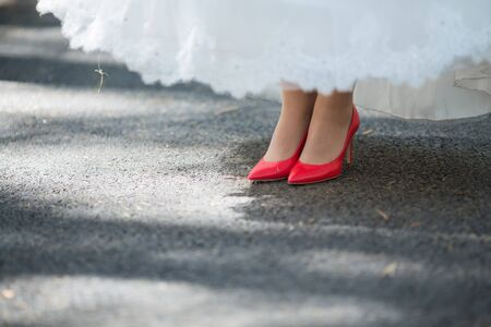 coral bell: Red Wedding shoes on the gatherings of the bride Stock Photo