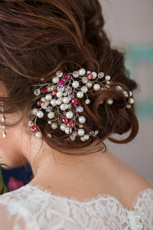 hairstyles: Wedding hairstyle of the bride, the beautiful decorations in the head. Wedding accessories. Female jewelry for girls. Details for marriage and for a married couple Stock Photo