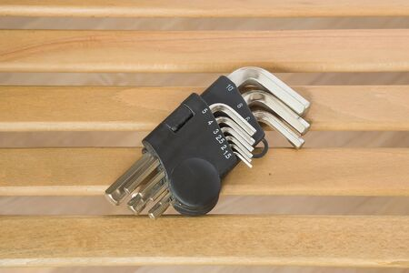 hex key: hex key hexahedron set on wood background Stock Photo