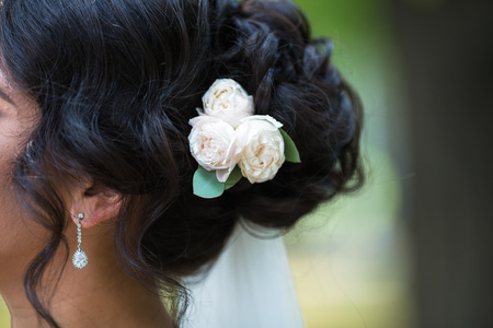 barrette: Black wedding hair styling. Brunette bride with curly hairstyle with barrette. Wedding concept Stock Photo
