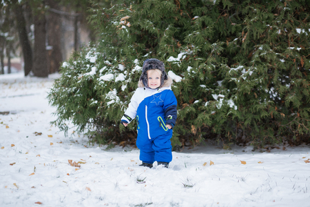 ac565a9d2 Year-old Laughing Baby Boy In Warm Snowsuit And A Cap Trapper ...